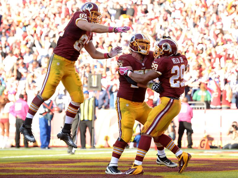 The Redskins celebrate Roy Helu's late touchdown