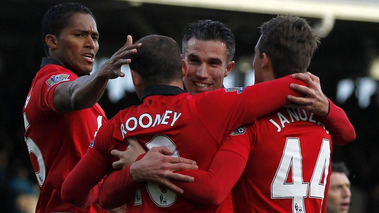 Manchester United celebrate on the way to a 3-1 win at Fulham