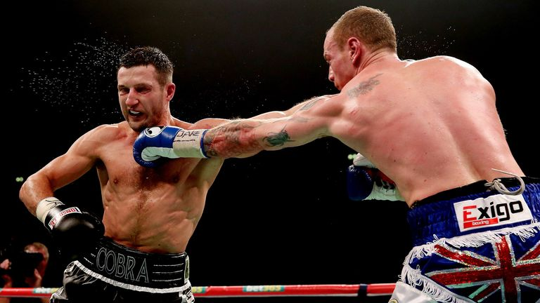Carl Froch (l) trading blows with George Groves last weekend