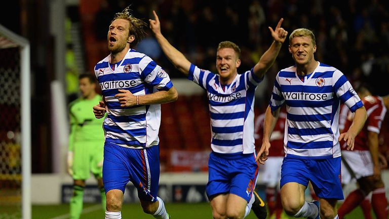 Kaspars Gorkss: Celebrates Reading's second goal at the City Ground