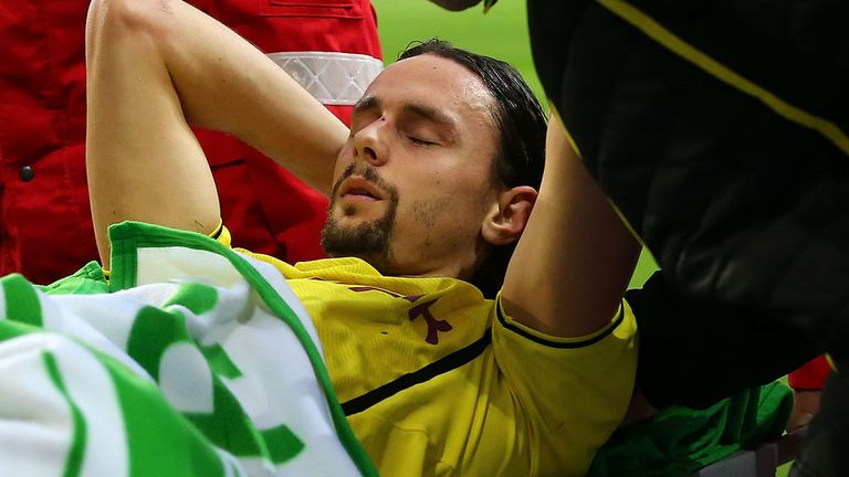 Dortmund defender Neven Subotic being carried off at Wolfsburg