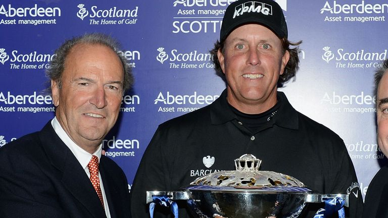 Phil Mickelson with the spoils of victory in July of this year
