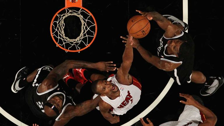 Chris Bosh goes for a block in Miami's narrow defeat by Brooklyn