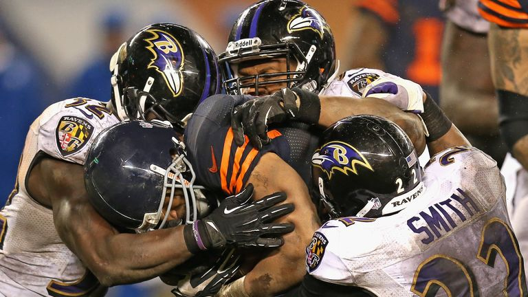 Matt Forte of the Chicago Bears tries to run his way through the Baltimore Ravens