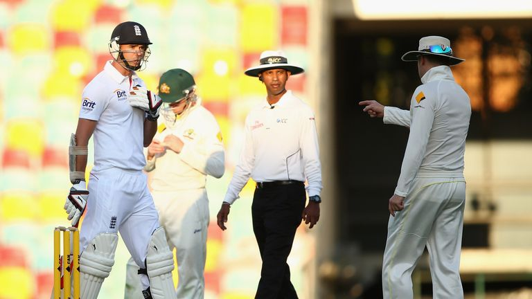 Michael Clarke (right) clashes with James Anderson