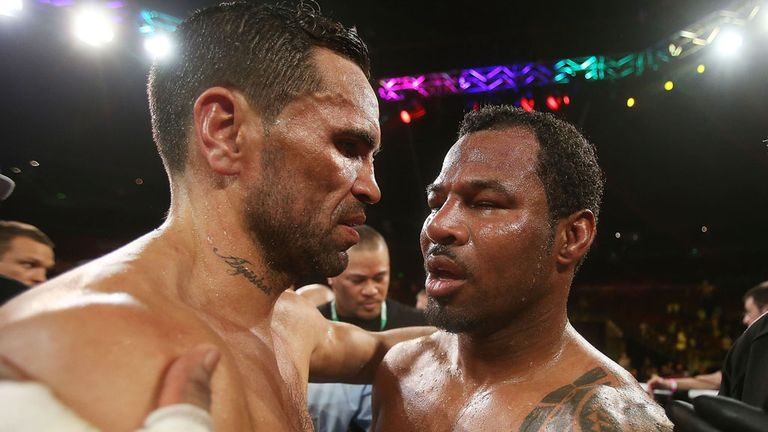 Anthony Mundine and Shane Mosley (r) embrace after the fight