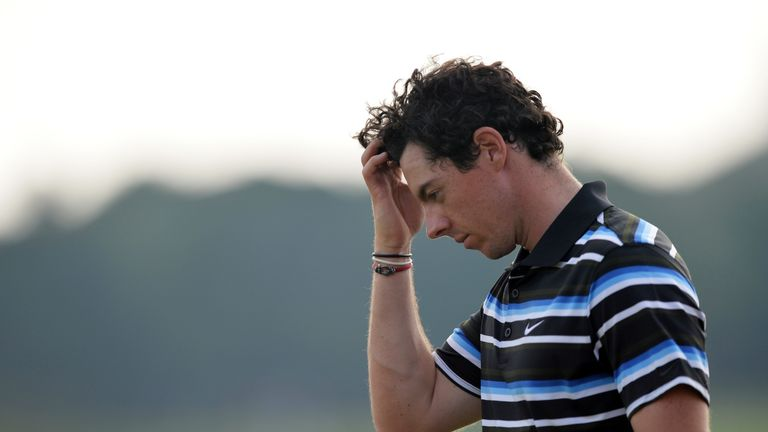 Rory McIlroy reacts to his bogey at the 18th hole in round two