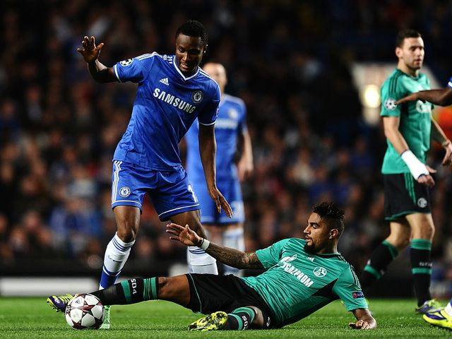 Mikel tries to avoid Boateng.