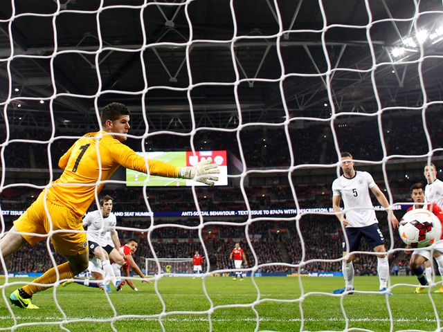 Alexis Sanchez heads the opening goal of the game at Wembley