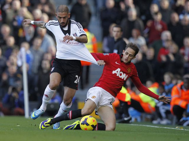 Dejagah tries to escape from Januzaj