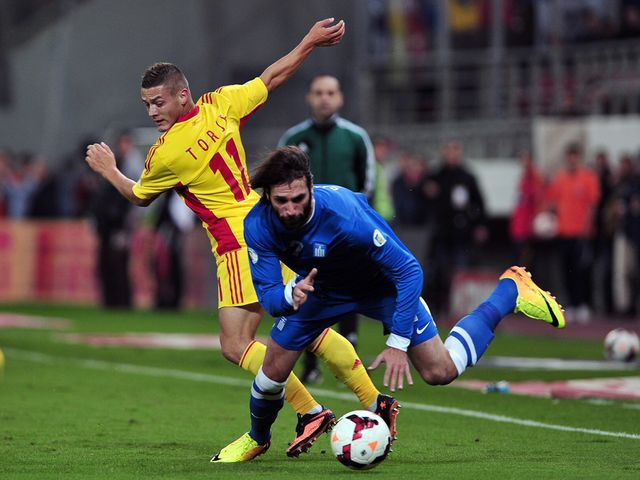 Gabriel Torje and Giorgos Samaras battle for the ball