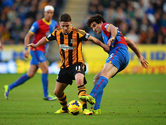 Robbie Brady tries to get past Mile Jedinak
