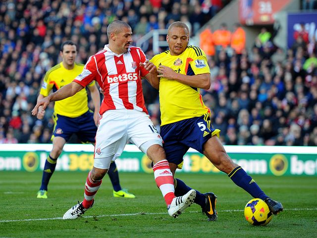 Jonathan Walters is tackled by Wes Brown