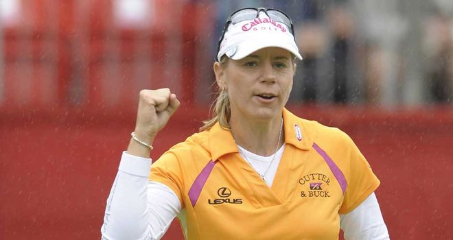 Annika Sorenstam celebrates winning her final tournament in 2008