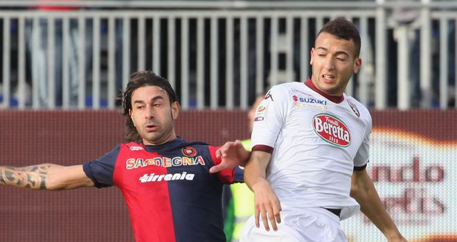 Daniele Conti battles for the ball against Torino