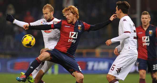 Davide Biondini (centre) scored Genoa's equaliser