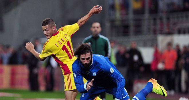 Gabriel Torje and Giorgos Samaras: Battling for the ball