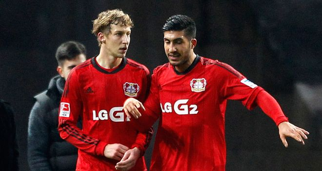 Stefan Kiessling (left) of Leverkusen celebrates with Emre Can