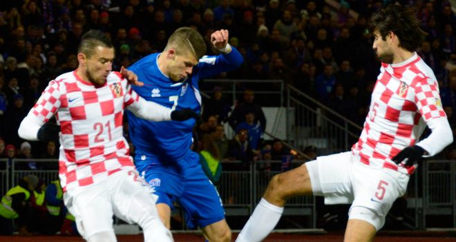 Gudmundsson: Tries to squeeze past Pranjic and Corluka