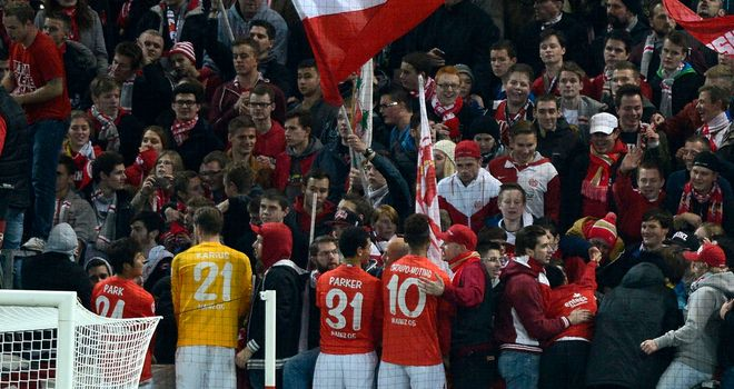 Players of Mainz celebrate with their supporters