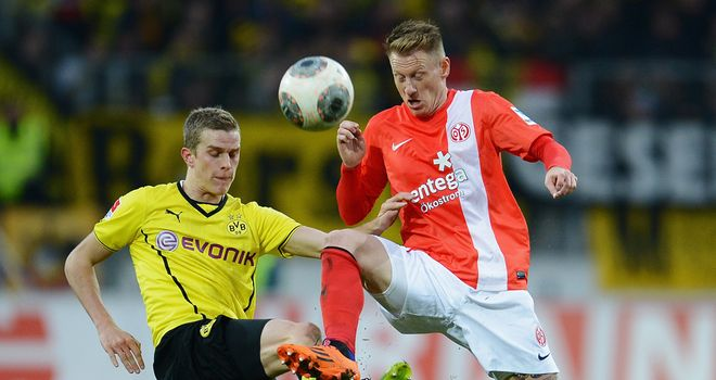 Sven Bender and Niki Zimling tussle for the ball