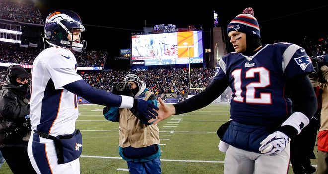 Manning and Brady shake hands after the Patriots defeat the Broncos 34-31 in overtime