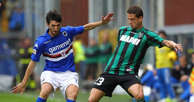 Davide Gavazzi and Marcello Gazzola battle for the ball