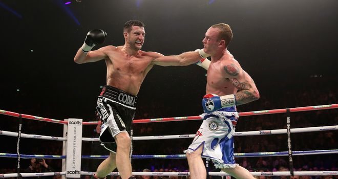 Carl Froch connects with George Groves during their IBF and WBA World super-middleweight bout
