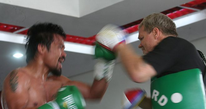 Manny Pacquiao trains with Freddie Roach