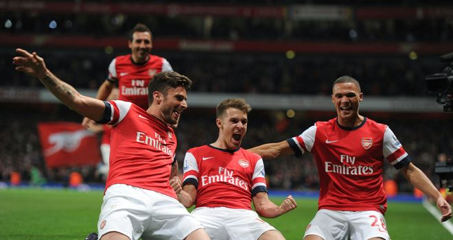 Arsenal celebrate as Aaron Ramsey's goal clinched a 2-0 win over Liverpool