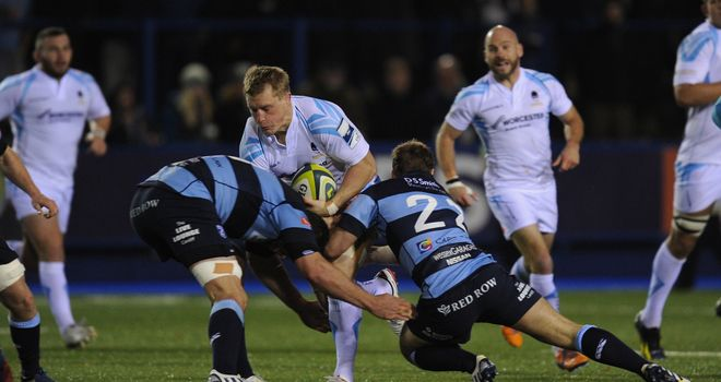 Worcester player Jake Abbott runs into the Blues defence
