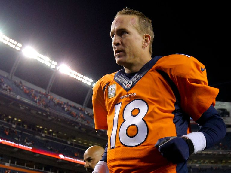 Peyton Manning leaves the field after Broncos' victory