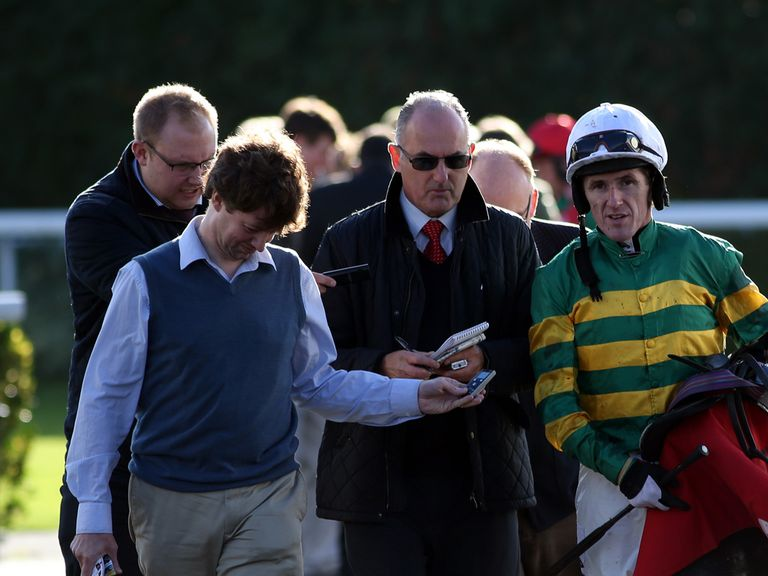 The press hang off every word after a winner at Kempton on Monday