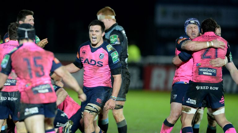 The Cardiff Blues players celebrate after the final whistle