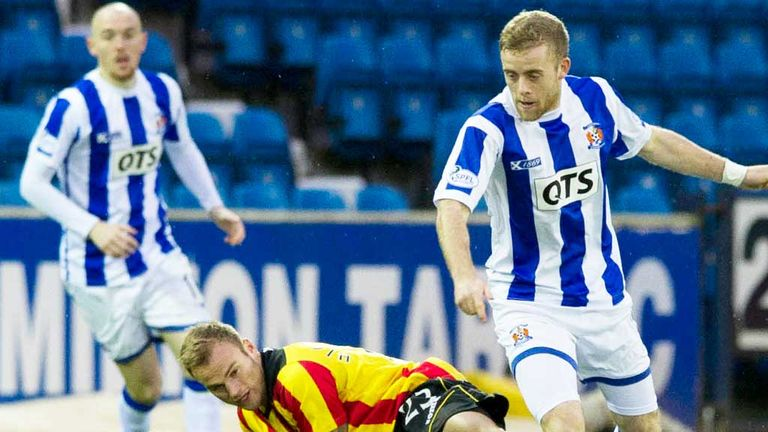 Partick's Kallum Higginbotham challenges Sammy Clingan of Kilmarnock (right)