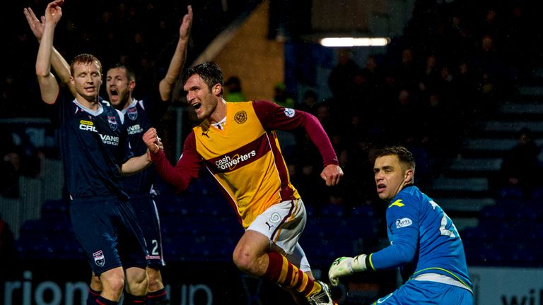 John Sutton celebrates opening the scoring in Dingwall