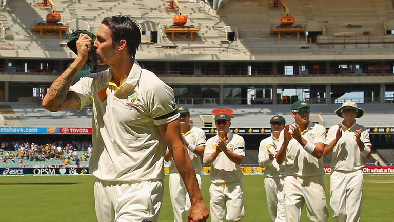 Mitchell Johnson: Australia seamer kisses his Baggy Green after taking 7-40 on day three
