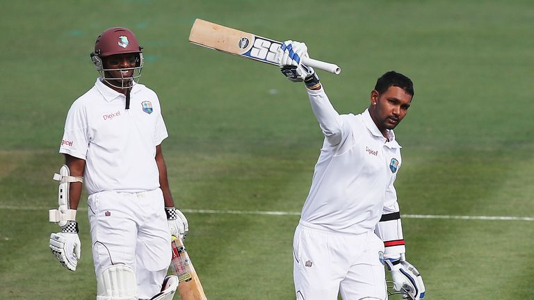 Denesh Ramdin celebrates his century during a crucial stand with Shivnarine Chanderpaul (left)