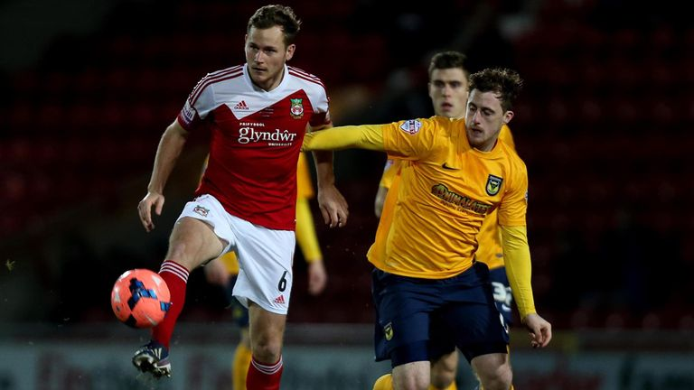 Joe Clarke: Wrexham goalscorer battles with Oxford's Scott Davies