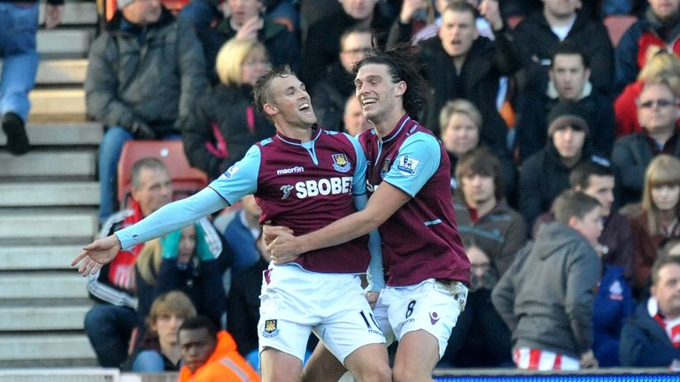 Jack Collison (l) and Andy Carroll: West Ham defender delighted to see striker return