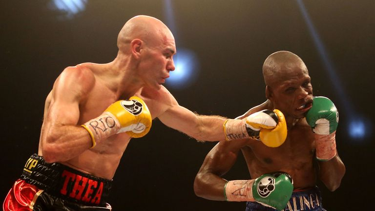 Stuart Hall (L): Won the vacant IBF bantamweight title in brutal contest