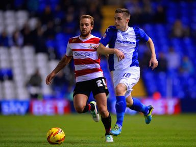 James Coppinger and Mitch Hancox battle for the ball