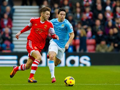 Adam Lallana surges clear of Samir Nasri