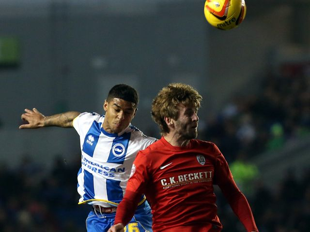 Liam Bridcutt challenges Paddy McCourt