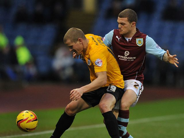 Burnley's Kieran Trippier holds up Barnsley's Tomasz Cywka