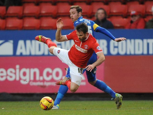 Charlton's Rhoys Wiggans is fouled by Richard Keogh