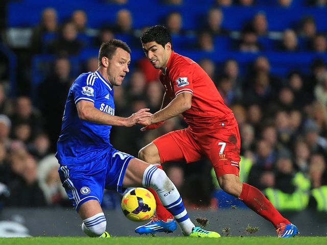John Terry tries to stop Luis Suarez