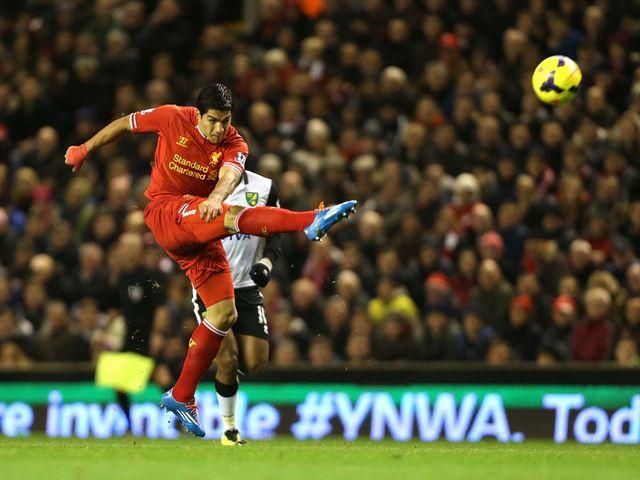 Luis Suarez scores his opening goal with this terrific strike