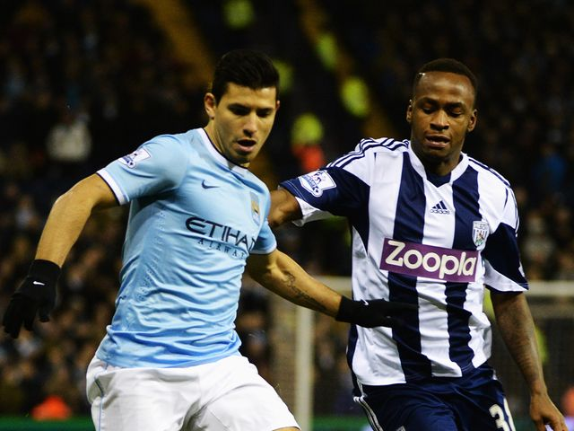 Sergio Aguero and Saido Berahino battle for the ball