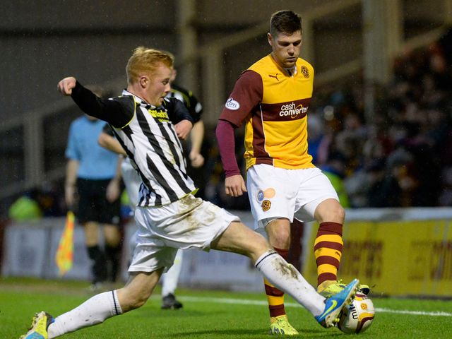 Iain Vigurs is challenged by St Mirren's Conor Newton